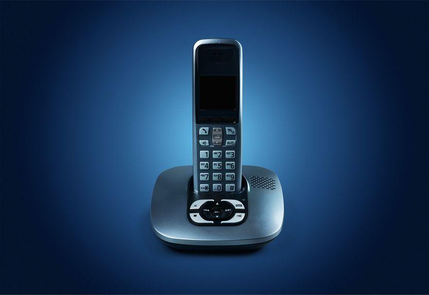 Imagem de telefone sem fio azul na base