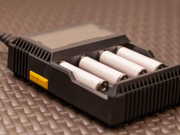Stack of rechargeable AA batteries being recharged – Close up shot