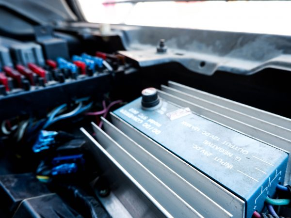 Power Inverters, DC to AC from separate car batteries on a white background